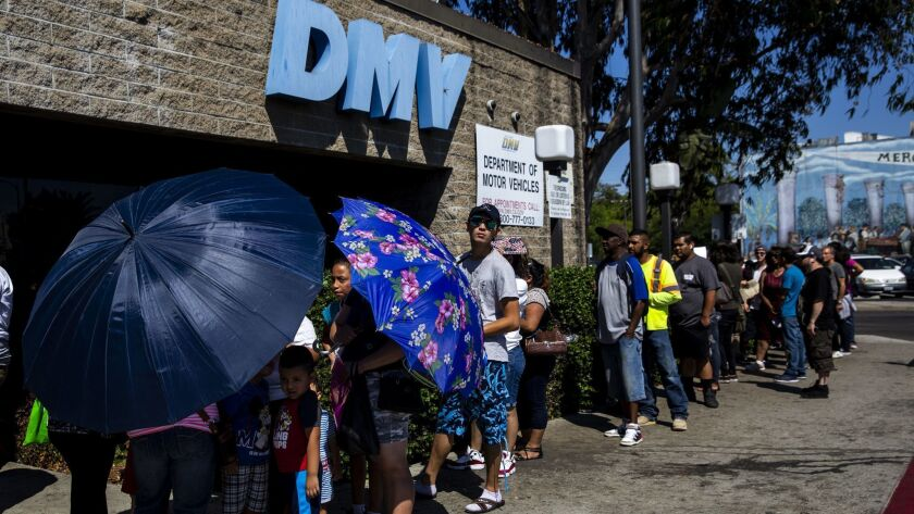 LOS ANGELES, CALIF. - AUGUST 07: A line of people wait to be helped at a California Department of Mo