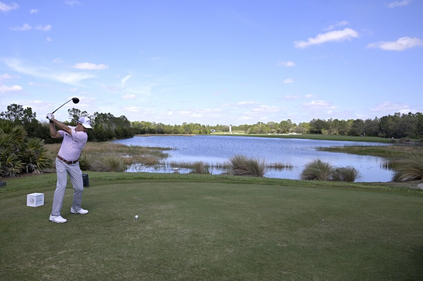 FILE- In this Sunday, Feb. 28, 2021 file photo, Kevin Kisner tees off on the 13th hole during the final round of the Workday Championship golf tournament, in Bradenton, Fla. Kisner is among four players on the PGA Tour board who had to work through a plan to return to golf from the COVID-19 pandemic. (AP Photo/Phelan M. Ebenhack, File)