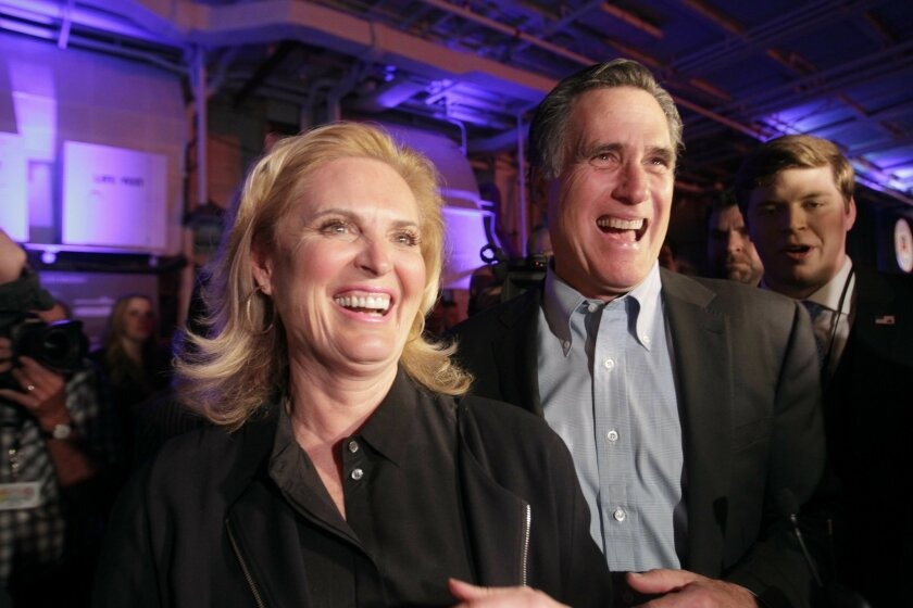Mitt Romney, the 2012 Republican nominee for President, and his wife Ann Romney mingle with the crowd after Mitt Romney spoke while on board the USS Midway Museum in San Diego on Friday.