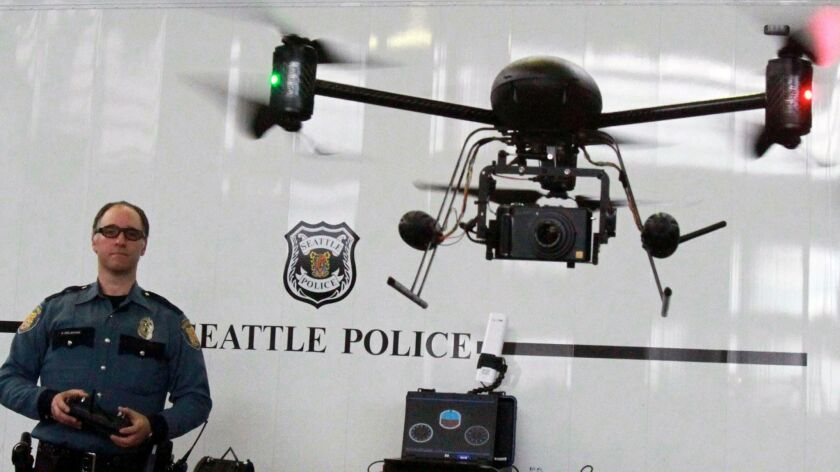 A Seattle police officer flies a drone in 2012. After public outcry, the Seattle Police Department grounded it drone initiative, giving the unmanned aircraft to the LAPD. The LAPD recently destroyed those devices but wants to test another model during a pilot program.