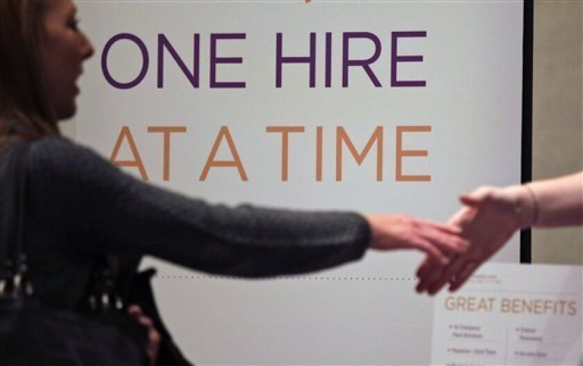 In this Nov. 30, 2010 photo, Satila Higgins, of Evansville, Indiana, speaks with a prospective employer at a career fair in San Diego. Employers posted a sharp increase in job openings in October, raising hopes that hiring could pick up in the coming months.(AP Photo/Gregory Bull)