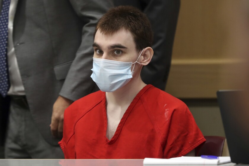 FILE - In this July 14, 2021, file photo, Parkland school shooter Nikolas Cruz sits in court during a pre-trial hearing at the Broward County Courthouse in Fort Lauderdale, Fla. Attorneys for Cruz, the suspect in a 2018 Florida high school massacre, told a judge Tuesday, Aug. 10, 2021, that the media and public should be barred from all pretrial hearings, saying Cruz's right to an impartial jury will be irrevocably harmed if certain evidence is revealed before jurors are seated. (Amy Beth Bennett/South Florida Sun-Sentinel via AP, Pool, File)