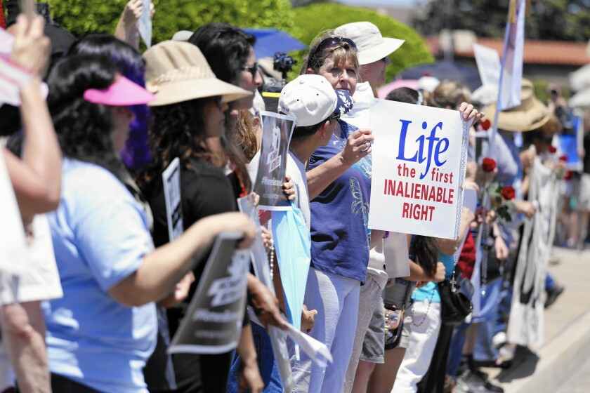 Anti-abortion protesters gather at the Planned Parenthood office in Orange. A judge has ordered an anti-abortion group not to release secretly made videos recorded at two meetings of the National Abortion Federation.
