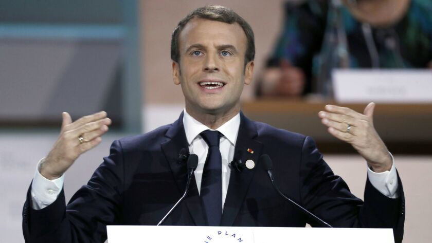 French President Emmanuel Macron delivers a speech as part of the plenary session of One Planet Summit in Boulogne-Billancourt, near Paris, on Dec. 12, 2017.