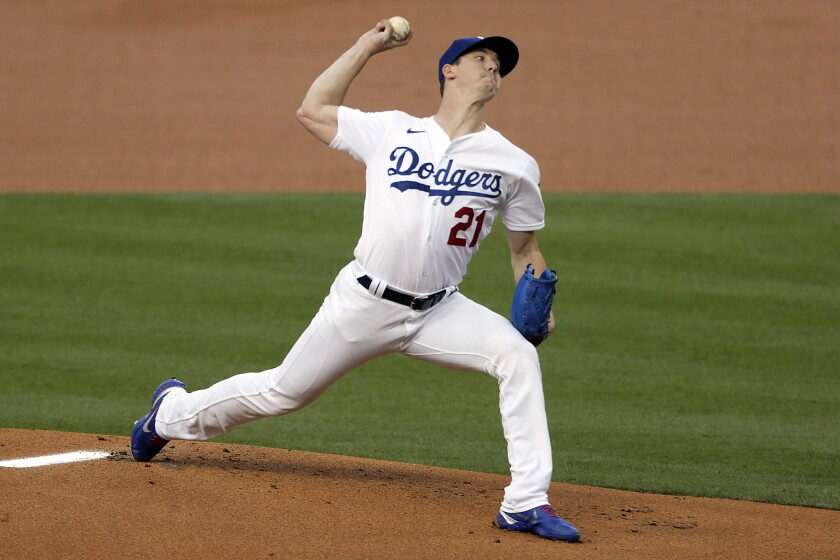 The Los Angeles Dodgers' Walker Buehler pitches against the Colorado Rockies on Aug. 21, 2020.