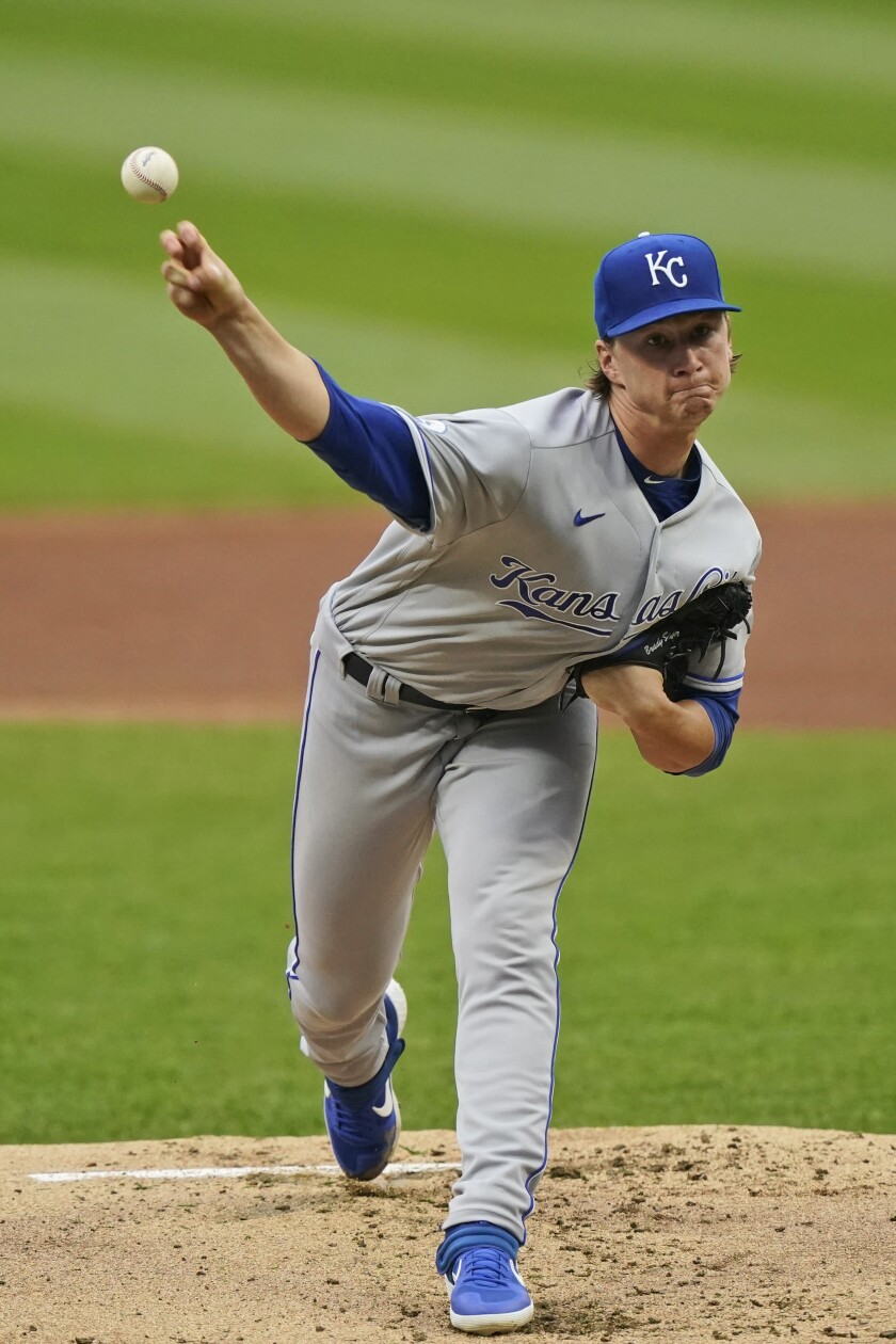 Kansas City Royals starting pitcher Brady Singer delivers in the first inning of the team's baseball game against the Cleveland Indians, Thursday, Sept. 10, 2020, in Cleveland. (AP Photo/Tony Dejak)