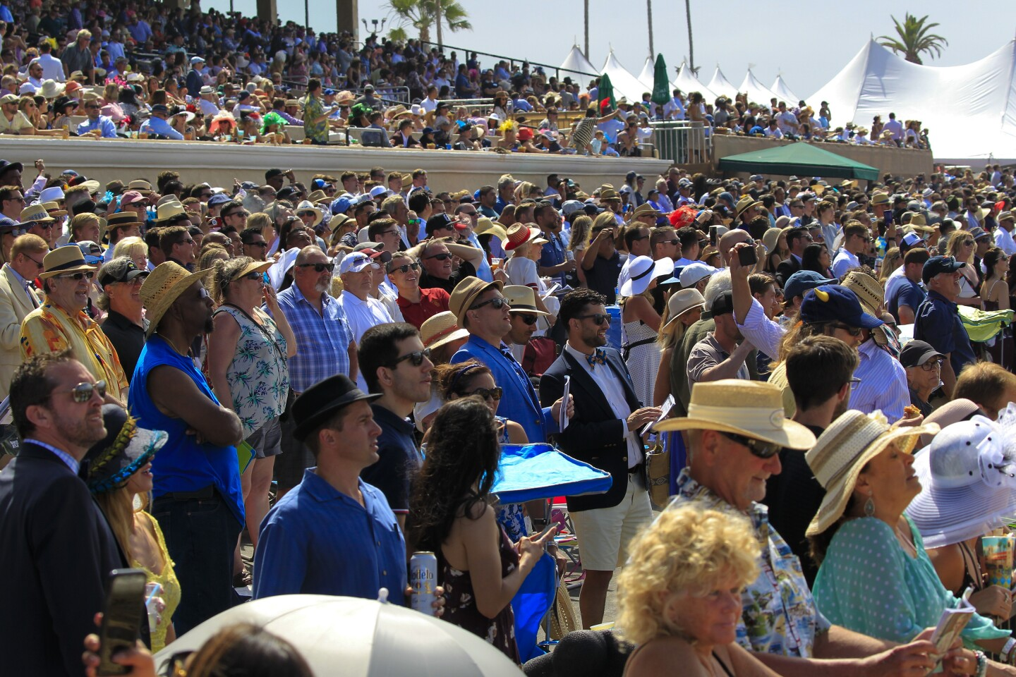 Race fans cheer for their horse on Opening Day at Del Mar Racetrack on Wednesday July 17th, 2019.