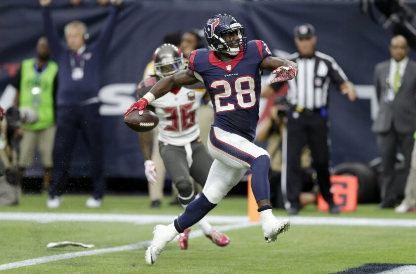 Houston Texans' Alfred Blue (28) rushes for a touchdown against the Tampa Bay Buccaneers during the second half of an NFL football game Sunday, Sept. 27, 2015, in Houston. (AP Photo/David J. Phillip)