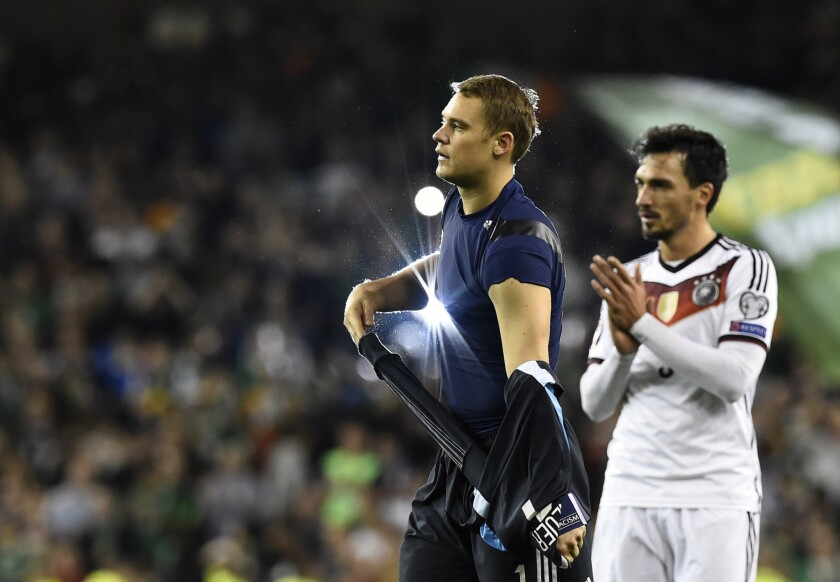 Germany goalkeeper Manuel Neuer and defender Mats Hummels, right, walk from the pitch after losing a UEFA Euro 2016 Group D qualifying match to Ireland on Oct. 8.