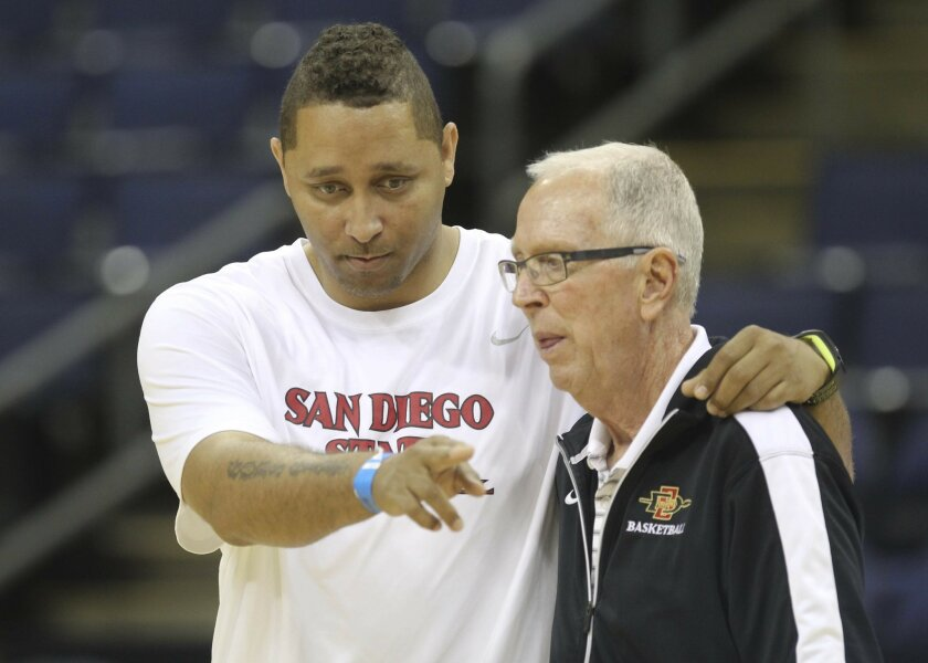 Assistant Coach Tony Bland shares some thoughts with Aztecs head coach Steve Fisher