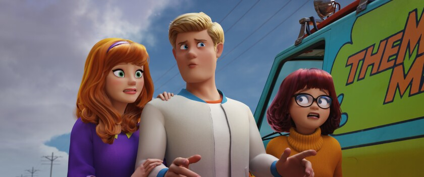 "Daphne (voiced by Amanda Seyfried), Fred (Zac Efron) and Velma (Gina Rodriguez) in the movie ""Scoob!"""