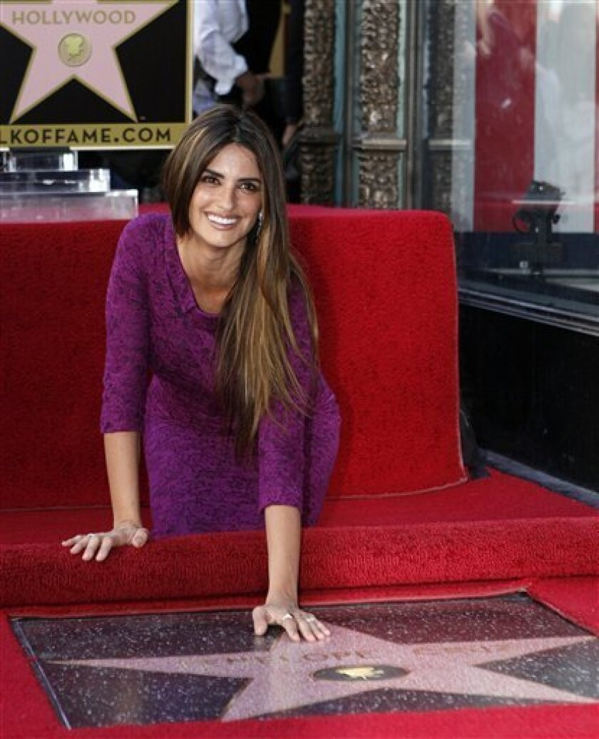 Spanish actress Penelope Cruz poses as she is honored with a star on the Hollywood Walk of Fame on Friday, April 1, 2011 in Los Angeles. (AP Photo/Damian Dovarganes)