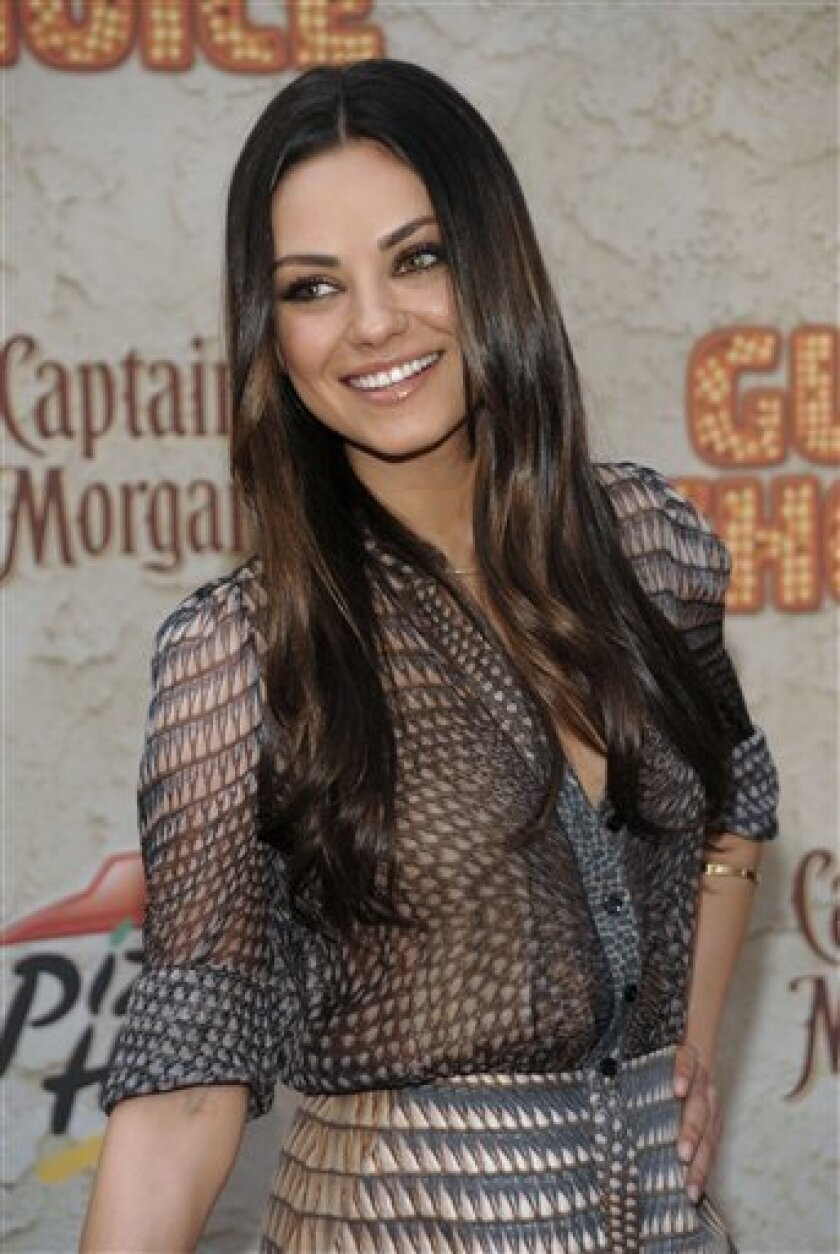 FILE -- In a June 4, 2011 file photo Mila Kunis arrives at the Spike TV Guys Choice Awards in Culver City, Calif. A Marine's YouTube request to go on a date with Mila Kunis got through to the actress. (AP Photo/Dan Steinberg)