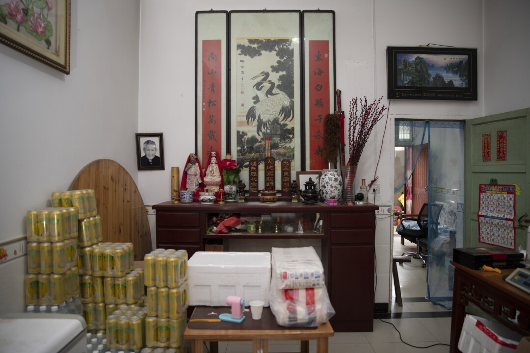 Pan Bangfeng converted the entrance hall to his home into a makeshift mini-mart during the lockdown.