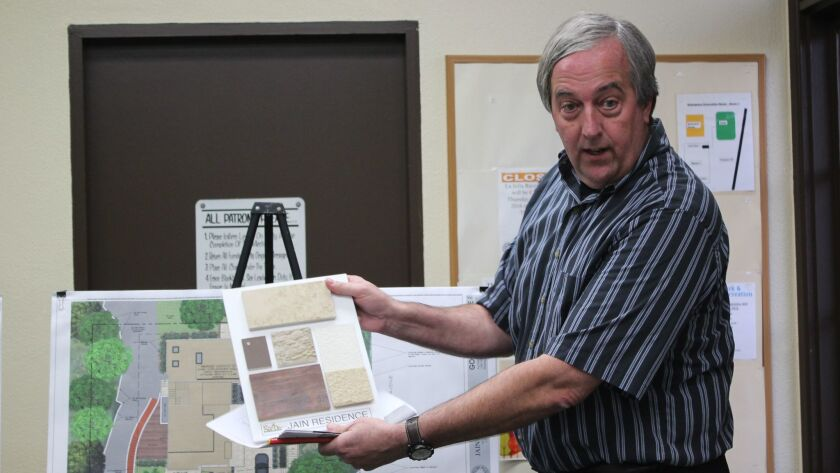 Tim Golba shows DPR committee members the materials planned for a new home on Soledad Avenue.