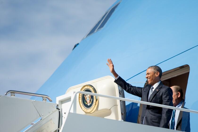 President Obama, accompanied by Alaska Gov. Bill Walker, steps off Air Force One after arriving at Joint Base Elmendorf-Richardson in Anchorage.