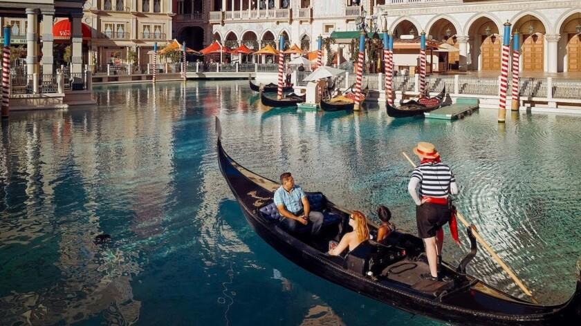 Guests of The Venetian Las Vegas can enjoy a gondola ride through an outdoor canal.