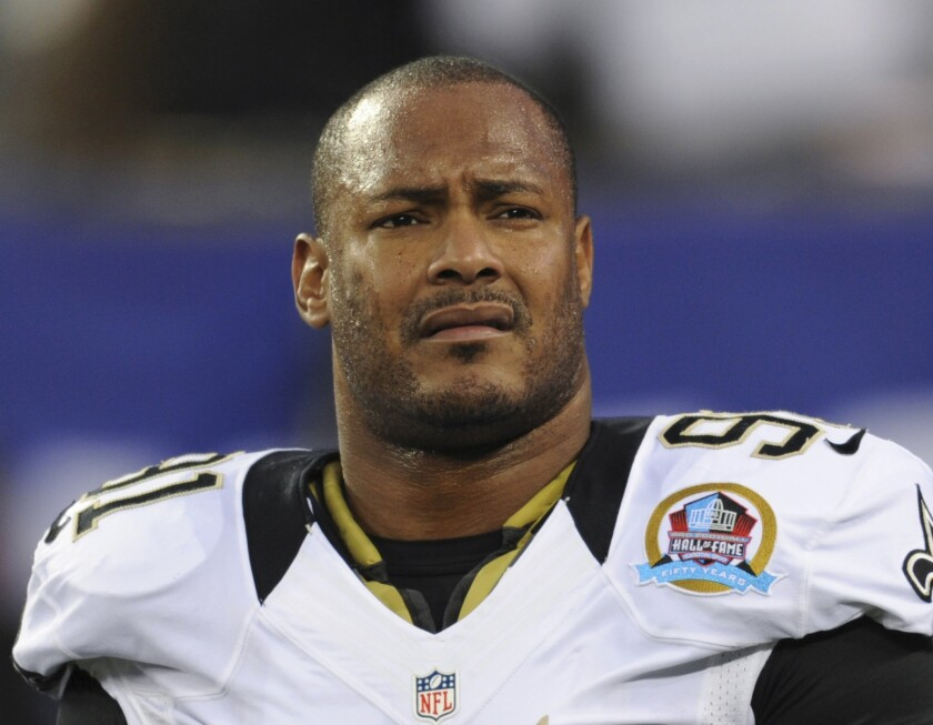 New Orleans Saints defensive end Will Smith appears before an NFL football game against the New York Giants on Dec. 9, 2012.