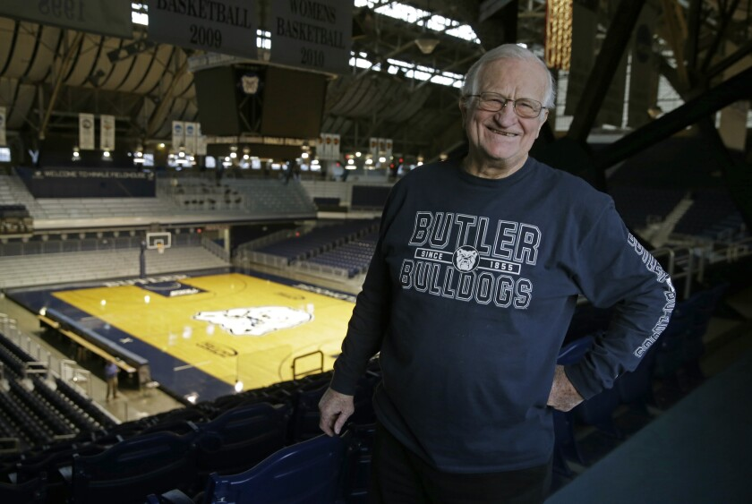 """FILE - In this Dec. 20, 2016, file photo, Bobby Plump, star of the 1954 Milan state championship basketball team, poses at Hinkle Fieldhouse in Indianapolis. """"The Indiana high school tournament is still special, not as special as it used to be, but it's still special,"""" said Plump, whose winning shot in the 1954 state championship game became the inspiration for """"Hoosiers."""" (AP Photo/Michael Conroy, File)"""