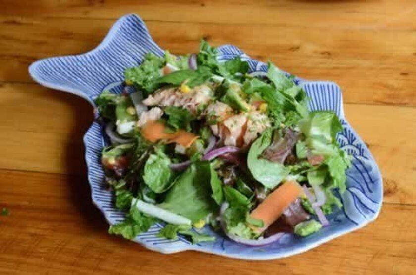 Su Casa Healthy Salad with salmon contains spring greens, jicama, corn, carrots, red onion and cilantro-vinaigrette dressing.