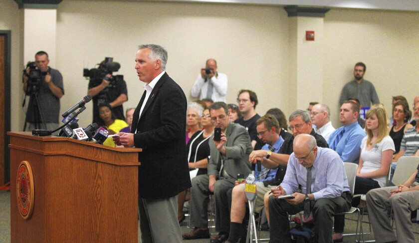 Dan Courtney gives a nontheistic invocation before the Town Board meeting in Greece, N.Y., on July 15. Courtney did so after town officials said that anyone, not just clergy, may deliver the opening invocation.