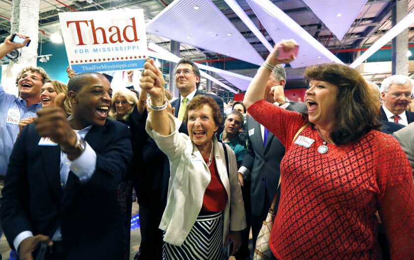 FILE - In this June 24, 2014 file photo, supporters of Sen. Thad Cochran, R-Miss., break into cheer as he is declared the winner in the primary runoff for the GOP nomination for U.S. Senate at his victory party in Jackson, Miss. Blacks turned out for Cochran against a tea party favorite, and winning means paying more attention to a constituency that includes thousands of black voters, who across the South are calling for the renewal of the Voting Rights Act. (AP Photo/Rogelio V. Solis, File)