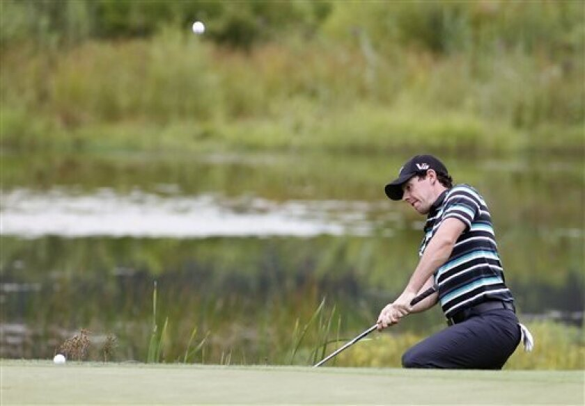 Rory McIlroy, from Northern Ireland, hits his third shot on the second hole out of the bunker during the second round of the Deutsche Bank Championship golf tournament in Norton, Mass., Saturday, Aug. 31, 2013. (AP Photo/Stew Milne)