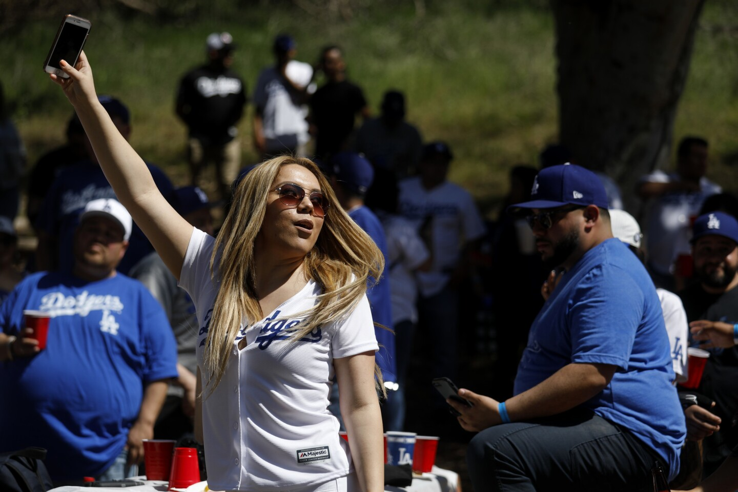 LOS ANGELES, CALIF. -- THURSDAY, MARCH 29, 2018: Melissa Enriquez, of Orange, dances to the music of Banda Tomateros de Culiacan at the Puro Pari 2018 Opening Day tailgate gathering at Elysian Park before the start of the Los Angeles Dodgers against the San Francisco Giants MLB game in Los Angeles, Calif., on March 29, 2018. (Gary Coronado / Los Angeles Times)