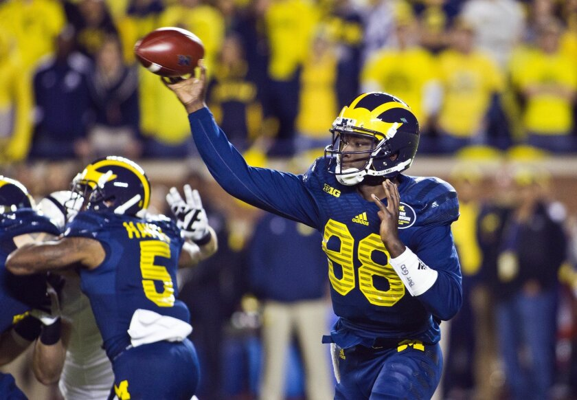 Michigan quarterback Devin Gardner (98) throws a pass in the second quarter of an NCAA college football game in Ann Arbor, Mich., Saturday, Oct. 11, 2014. (AP Photo/Tony Ding)