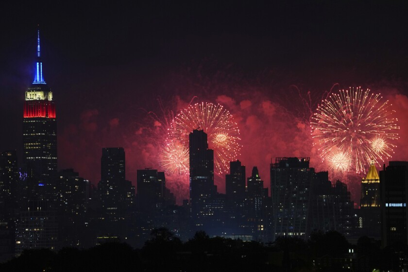 Fireworks explode over the New York City skyline during Macy's 4th of July fireworks display, late Sunday, July 4, 2021, as seen from Jersey City, N.J. (AP Photo/Charles Sykes)