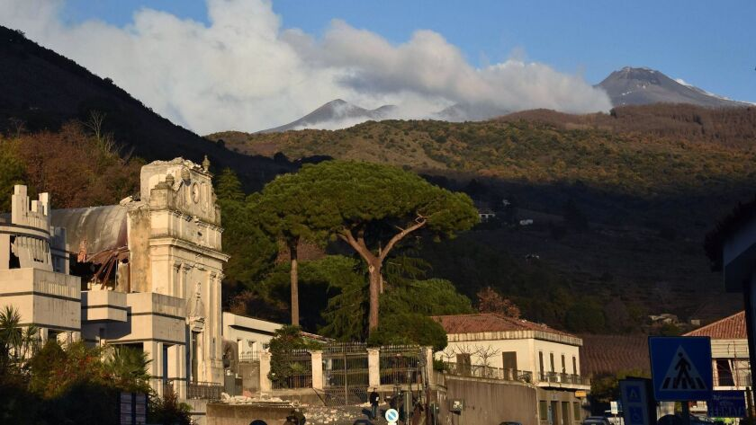 The facade of a church in Fleri, Italy, at the foot of the Mt. Etna volcano, shows damage after an earthquake hit the village on Dec. 26.