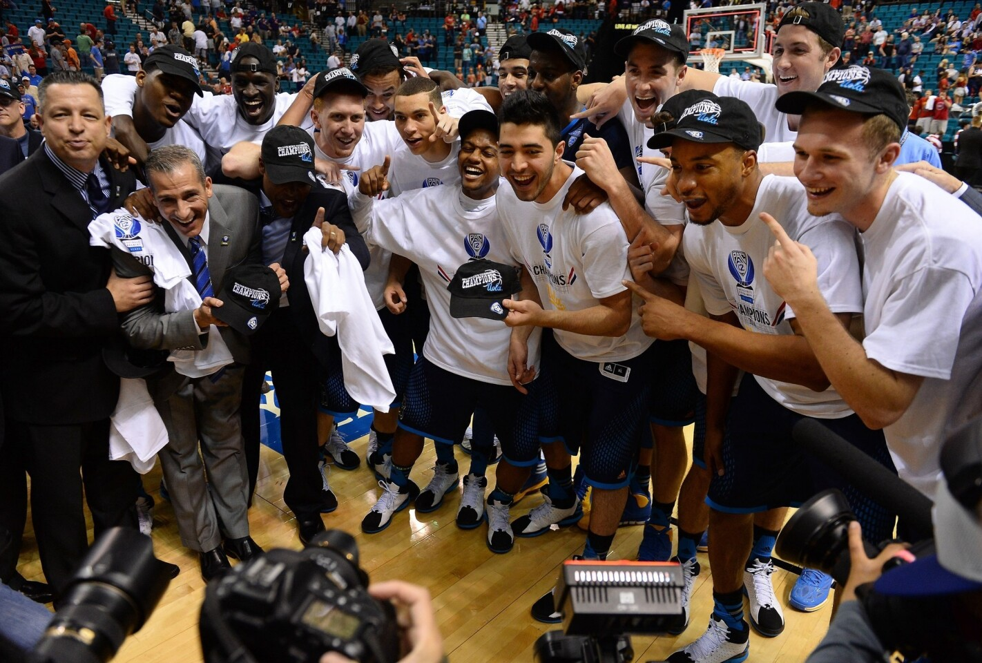 UCLA players celebrate their 75-71 upset win over Arizona in the Pac-12 tournament title game at the MGM Garden Arena in Las Vegas on Saturday.