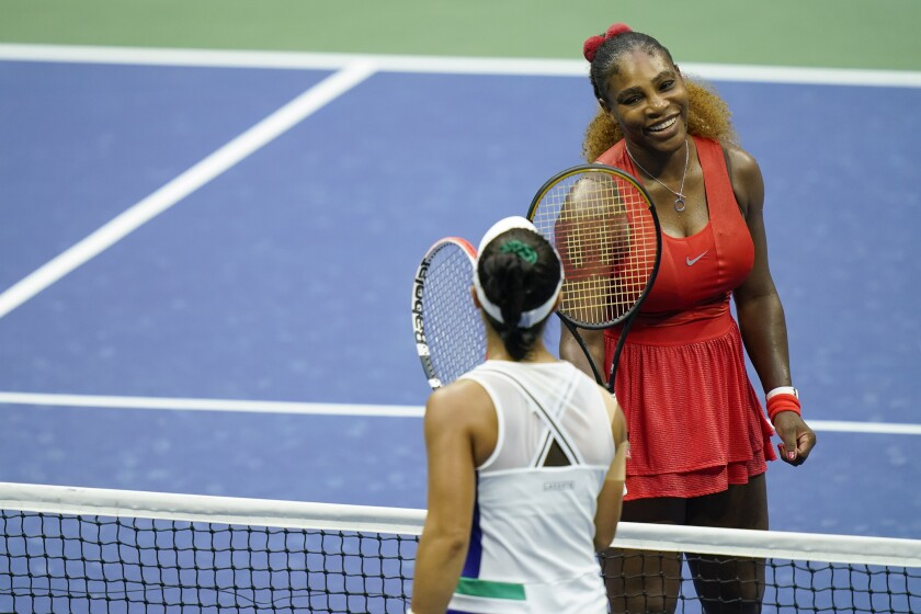 Serena Williams, of the United States, top taps rackets with Kristie Ahn, of the United States, after winning their first-round match of the US Open tennis championships, Tuesday, Sept. 1, 2020, in New York. (AP Photo/Seth Wenig)