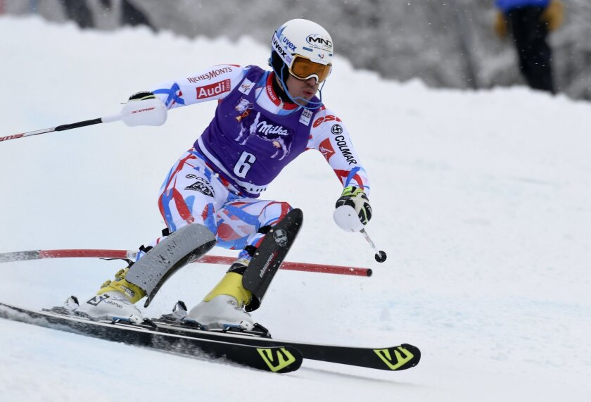 France's Victor Muffat-Jeandet speeds down the course during the slalom portion of a men's Alpine ski combined race, in Chamonix, France, Friday, Feb. 19, 2016. (AP Photo/Pier Marco Tacca)