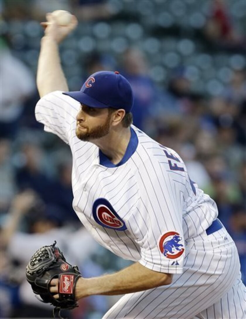 Chicago Cubs starter Scott Feldman throws against the San Diego Padres during the first inning of a baseball game in Chicago, Wednesday, May 1, 2013. (AP Photo/Nam Y. Huh)