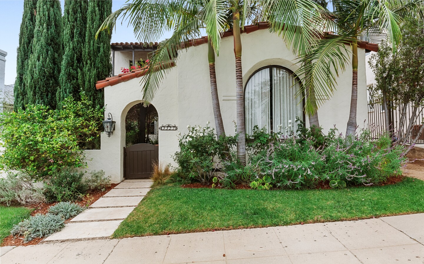 Built in 1932, the designer-done home includes a stylish backyard with a swimming pool and cabana surrounded by vegetable gardens and fruit trees.