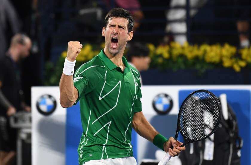 Novak Djokovic after defeating Stefanos Tsitsipas for the men's singles title at the Dubai championship.