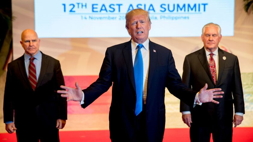 President Donald Trump, accompanied by Secretary of State Rex Tillerson, right, and National Security Adviser H.R. McMaster, left, at the East Asia Summit on Nov. 14 in Manila, Philippines.