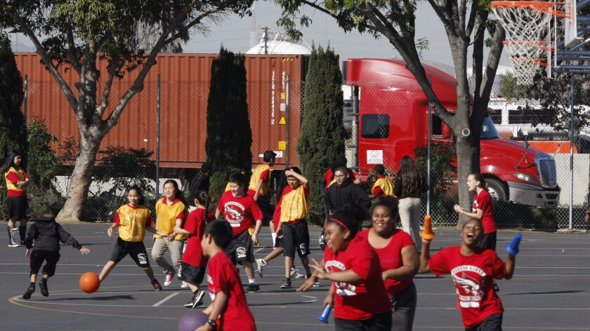A Long Beach school near an oil refinery, freeway, railroad line and seaport.