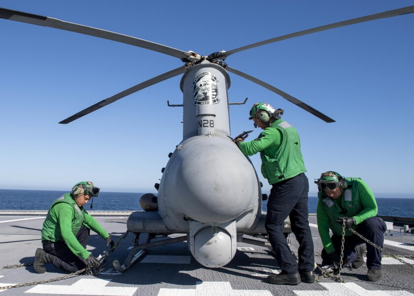 Sailors conduct pre-flight checks to an MQ-8B Fire Scout aboard Independence-variant littoral combat ship Charleston.