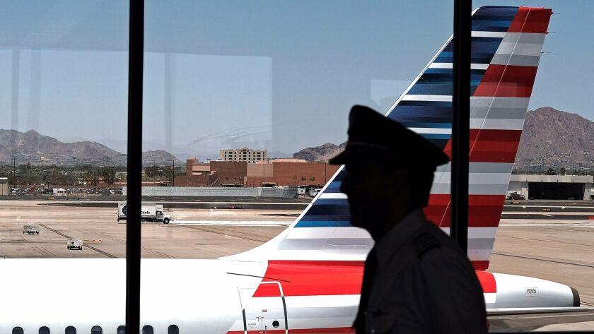 A pilot walks through the Phoenix airport.