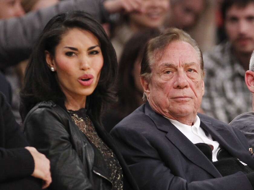 V. Stiviano and Donald Sterling watch the L.A. Clippers play in 2010. Sterling's wife is suing to recover $2.8 million in gifts Stiviano received from him.
