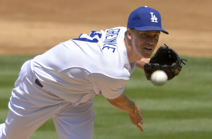 Dodgers starter Zack Greinke, pictured last August, says he could have continued pitching Thursday despite a mild calf strain.