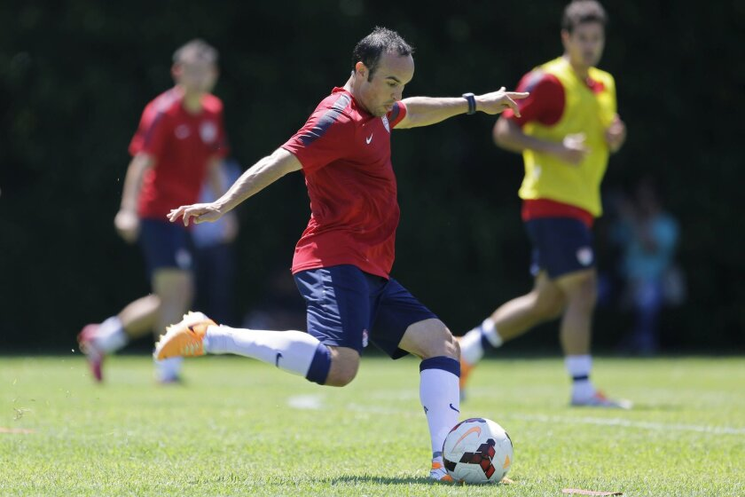 FILE - In this Jan. 22, 2014, file photo, United States' Landon Donovan kicks the ball during a soccer training session in Sao Paulo. Donovan and the U.S. soccer team are back home after a 12-day camp in Brazil, and they're ready to start figuring out how the pieces will fit at the World Cup. Even