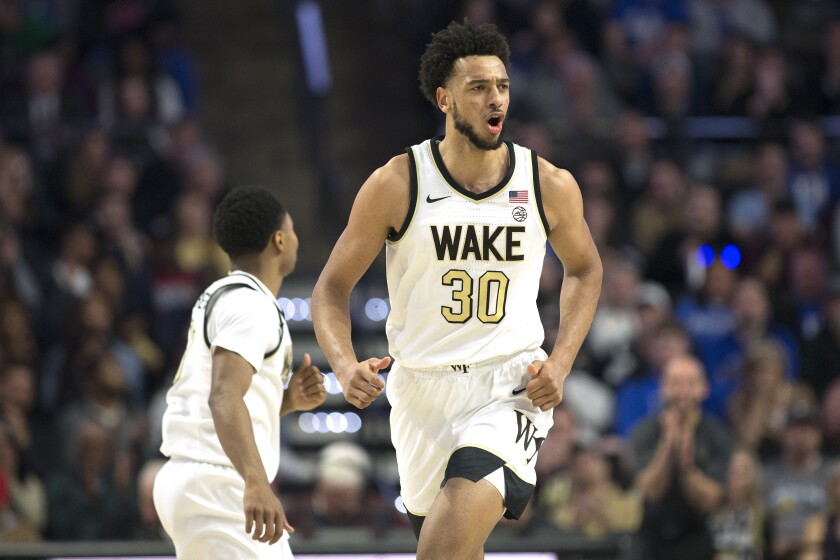 Wake Forest center Olivier Sarr (30) celebrates after scoring during the second half of the team's NCAA college basketball game against Duke on Tuesday, Feb. 25, 2020, in Winston-Salem, N.C. (AP Photo/Lynn Hey)