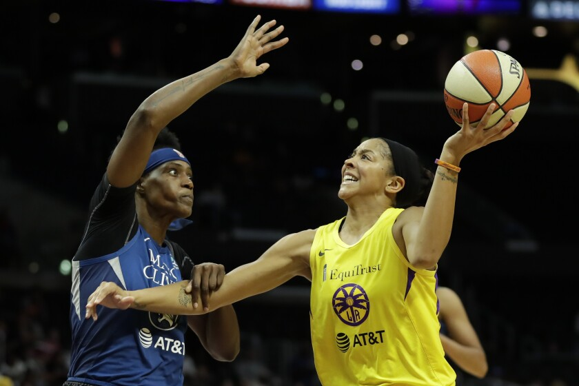 "FILE - In this Aug. 20, 2019, file photo, Minnesota Lynx center Sylvia Fowles, left, fouls Los Angeles Sparks forward Candace Parker during the second half of a WNBA basketball game in Los Angeles. Parker and her 11-year-old daughter are braving the start of an unprecedented WNBA season together in Florida. The Sparks All-Star knows it's a calculated risk to stay in the coronavirus hot spot, where all 12 teams will play games in the WNBA ""bubble"" of Bradenton. (AP Photo/Chris Carlson, File)"