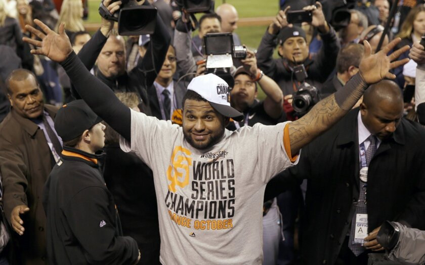 """FILE - In this Oct. 29, 2014, file photo, San Francisco Giants' Pablo Sandoval celebrates after Game 7 of baseball's World Series against the Kansas City Royals in Kansas City, Mo. The Giants won 3-2 to win the series. Giants assistant general manager Bobby Evans says he has been given """"every indication"""" the free agent third baseman will give careful consideration to re-signing with the World Series champions. (AP Photo/Matt Slocum)"""