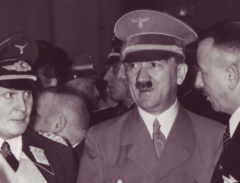 An historic photograph of Nazi leader Adolf Hitler wearing the visor hat that will be sold at auction Saturday in Germany. The hat and other Hitler artifacts are owned by Del Mar militaria dealer Craig Gottlieb.