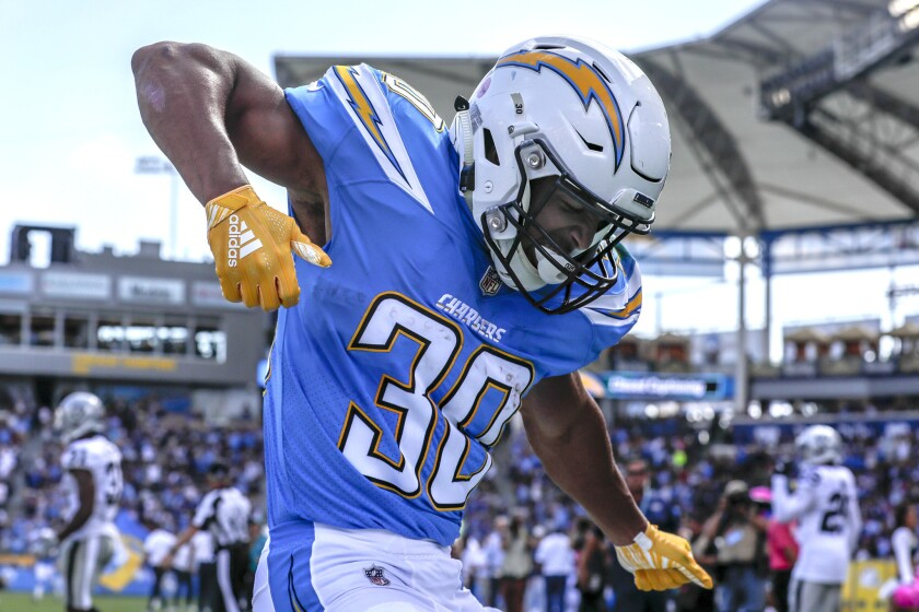 Chargers running back Austin Ekeler dances in the end zone after scoring a touchdown on a 44-yard screen pass from Philip Rivers on Oct. 7, 2018.