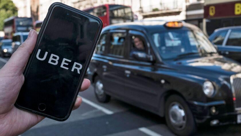 The Uber app on a mobile phone in central London